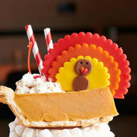 giant Thanksgiving turkeys marzipan candy lollipops in a milkshake closeup