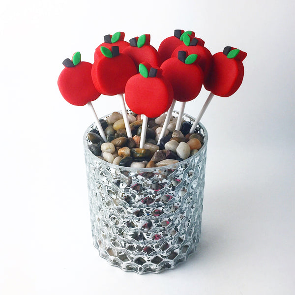 Rosh Hashanah red apples in a vase marzipan candy lollipops