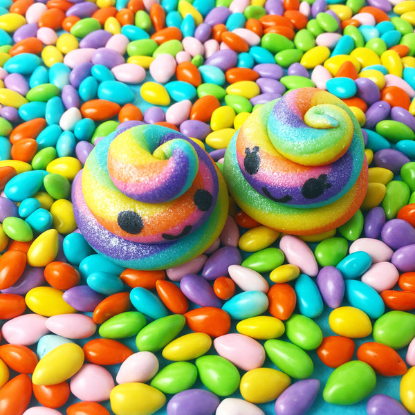 pair of kawaii rainbow unicorn poops marzipan candy sculpture treats with happy faces