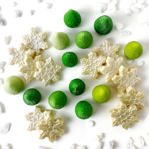 sparkly snowflakes and green trees marzipan candy sculpture treats top view