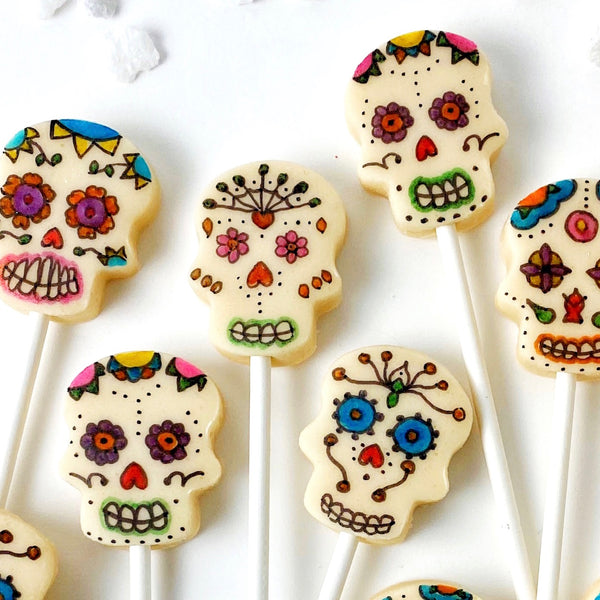 Day of the Dead sugar skull painted marzipan candy lollipops