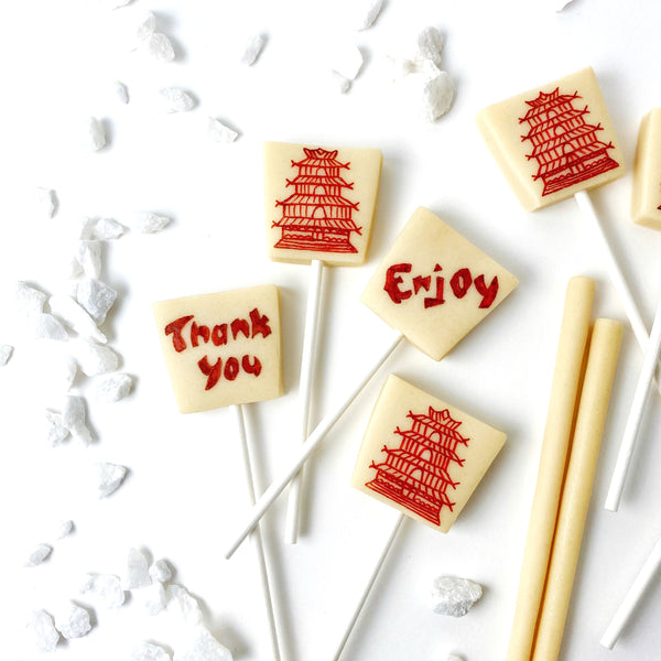 chinese takeout food boxes marzipan candy lollipops closeup