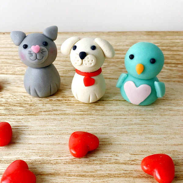Valentine's Day animals cat dog bird heart marzipan candy sculpture treats on wood