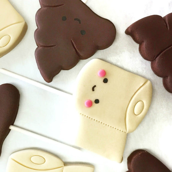 toilet paper & poop best friends marzipan candy lollipops close up