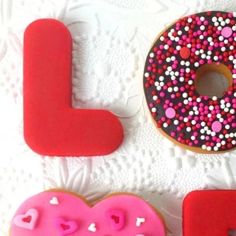 Valentine's Day love donuts doughnuts marzipan candy sculpture treats close up