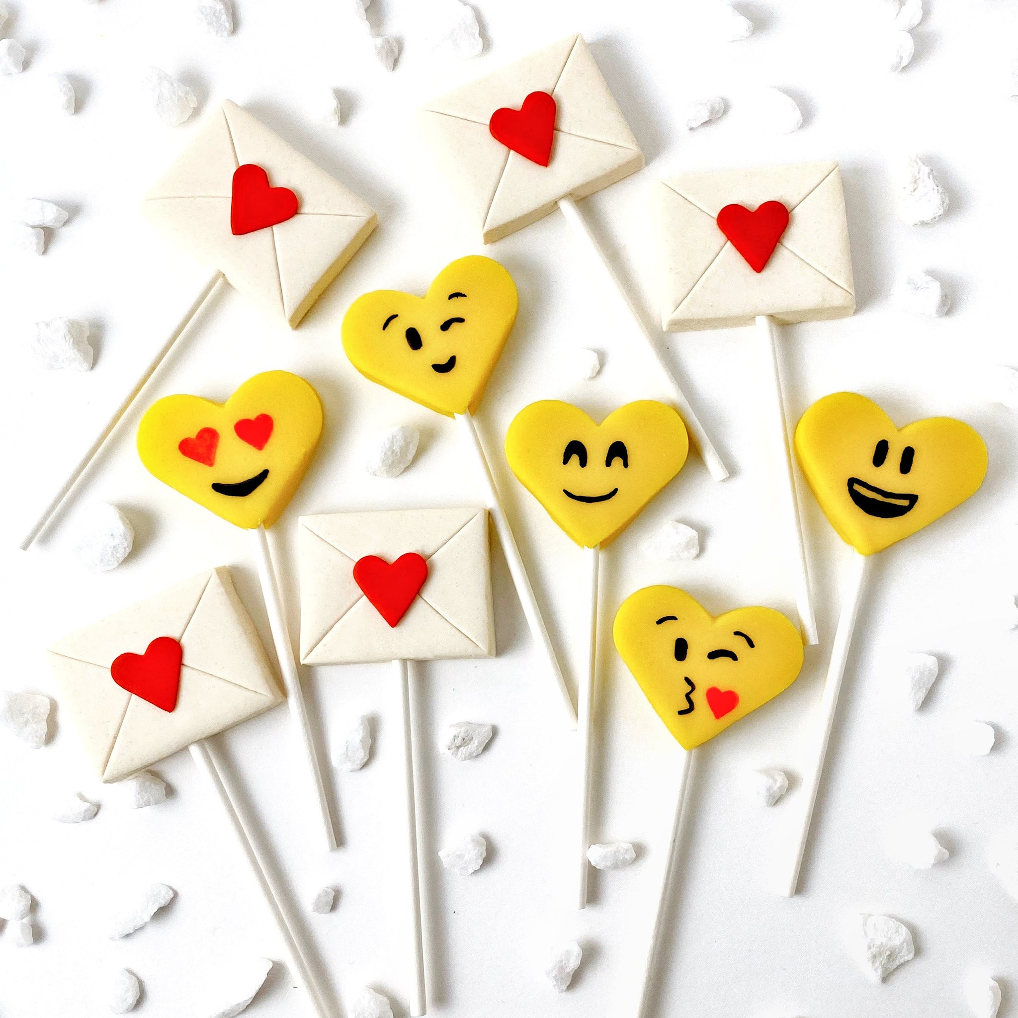 Valentine's Day yellow emoji hearts and love letters marzipan candy lollipops