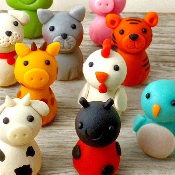 cute animal menagerie assorted marzipan candy sculptures closeup