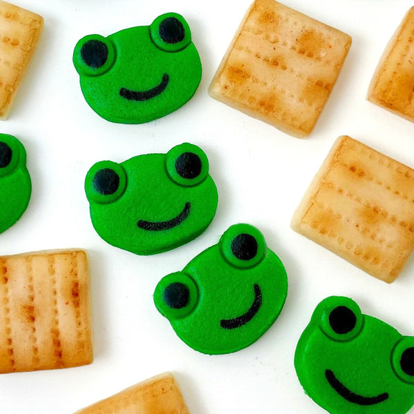 Passover matzah & green frogs mini marzipan candy bites closeup