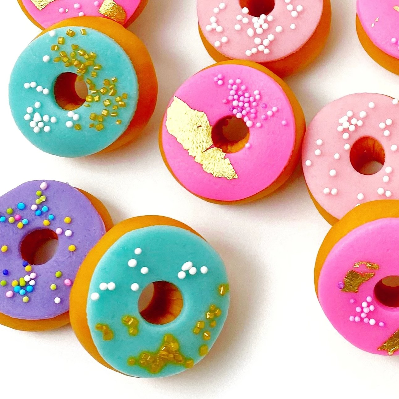 mini marzipan donuts sprinkles candy sculpture treats closeup