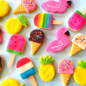 summer tropical marzipan candy treats with flamingos, pineapples, ice cream cones and popsicles