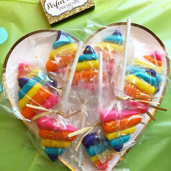 rainbow unicorn poop with gold stars candid shot marzipan candy lollipops