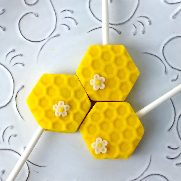Rosh Hashanah honeycomb and honeybee marzipan candy lollipops