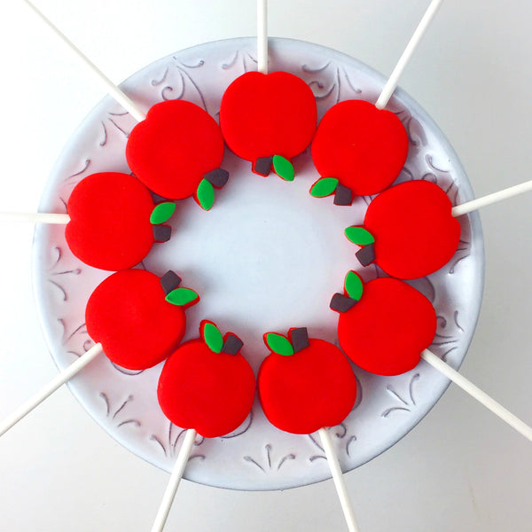 Rosh Hashanah red apples in a circle marzipan candy lollipops