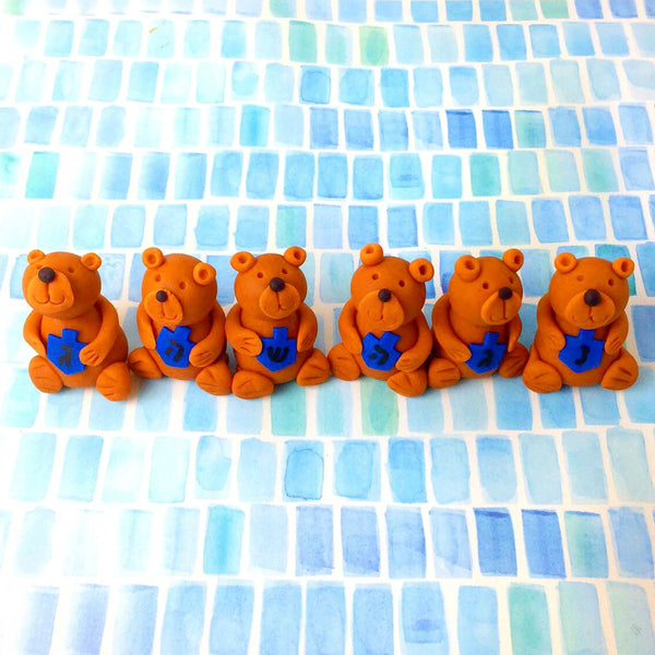Hannukah teddy bears holding dreidels in a row marzipan animal sculpture treats