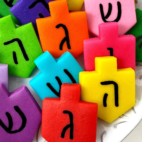 Hanukkah rainbow dreidels marzipan candy tiles on a plate