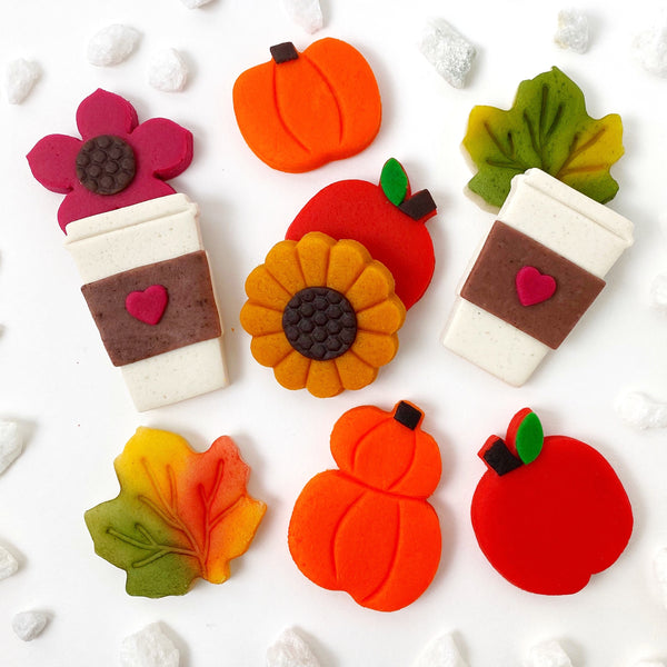 Autumn collection with pumpkins, coffee cups, flowers, maple leaves and apples marzipan candy tiles