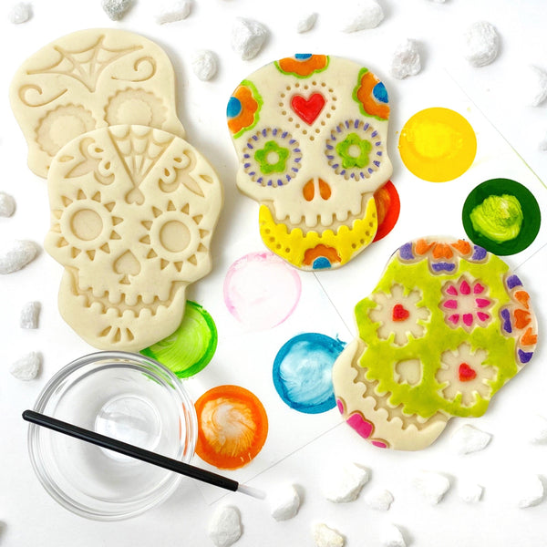 paint your own sugar skull marzipan candy treats laid out