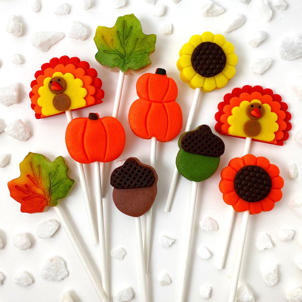 Thanksgiving collection with pumpkins, turkeys, sunflowers, maple leaves and acorns marzipan candy lollipops