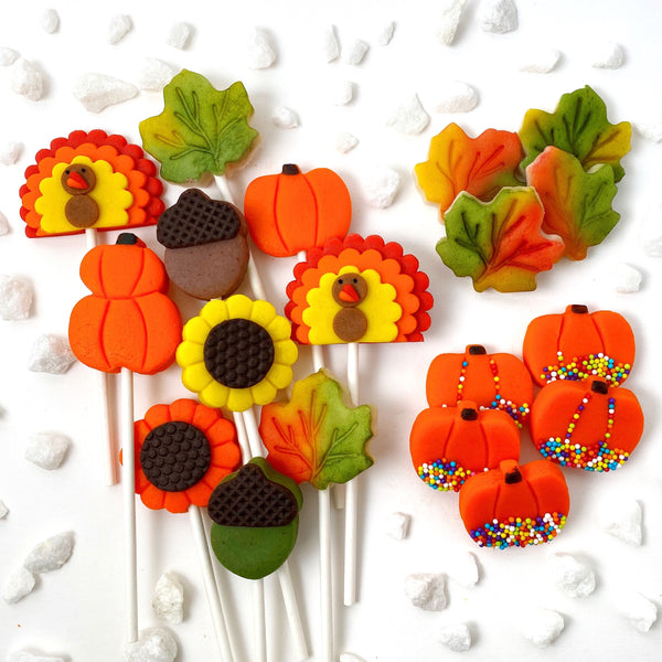 Thanksgiving ultimate collection with pumpkins, turkeys, sunflowers, maple leaves and acorns marzipan candy lollipops sprinkles
