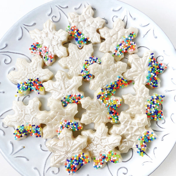 christmas sprinkle glitter snowflakes on a plate