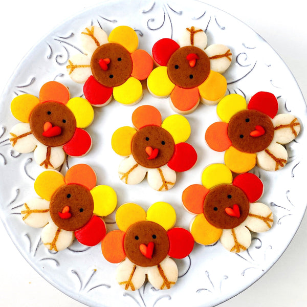 Thanksgiving turkey flowers marzipan candy tiles on a plate