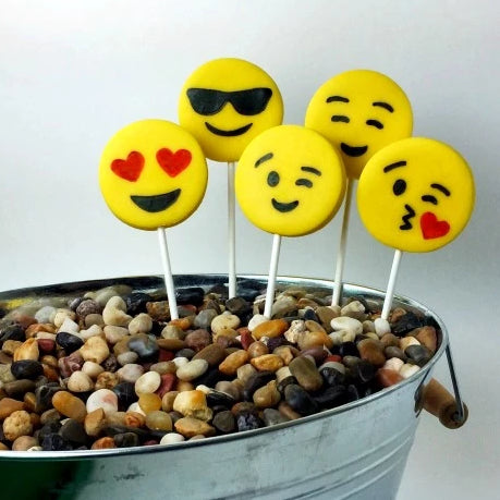 yellow emoji marzipan candy lollipops in a planter