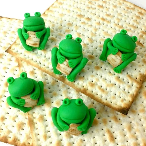 Passover Seder frogs holding matzah candy sculpture treats from the ten plagues
