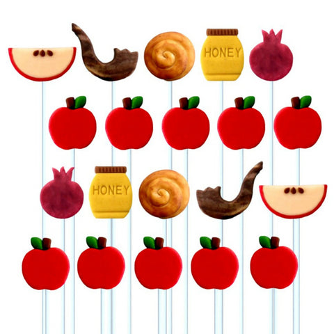 Rosh Hashanah super set with many apples and symbols - shofar, challah, pomegranate and honey - marzipan candy lollipops