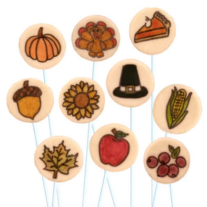 Thanksgiving hand-drawn icons with pumpkins, pilgrims, turkeys and pie marzipan candy lollipops