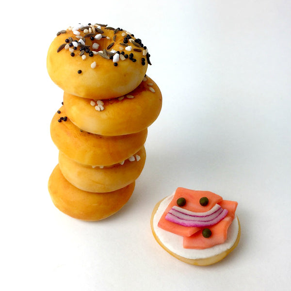mini bagels with poppy, sesame and lox marzipan candy sculpture treats in a stack