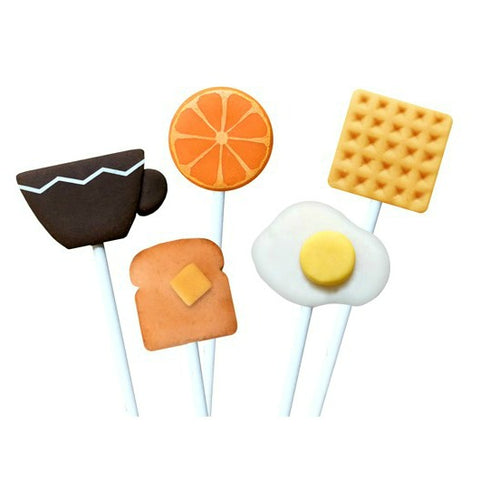 breakfast foods with waffle, orange, sunnyside egg, toast and coffee cup marzipan candy lollipops