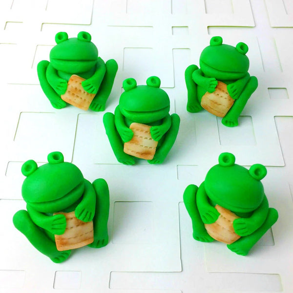 Passover Seder frogs holding matzah array candy sculpture treats from the ten plagues