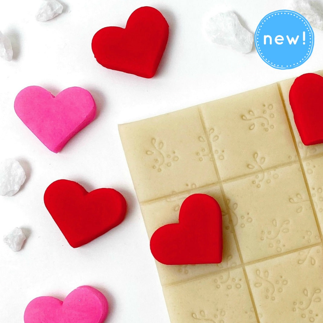 Valentine's Day hearts tic tac toe marzipan candy treats close up