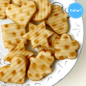 passover matzah marzipan assorted shape tiles closeup