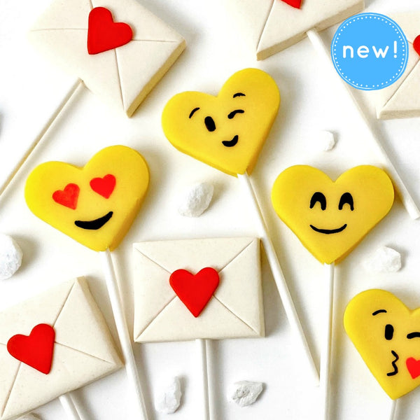 Valentine's Day yellow emoji hearts and love letters marzipan candy lollipops close up