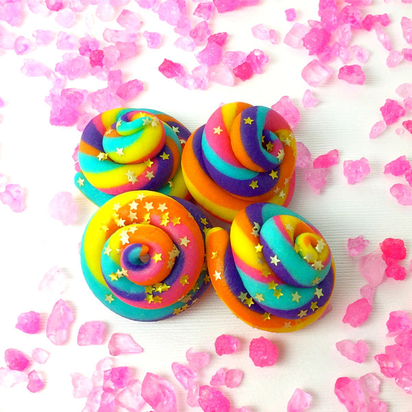 rainbow unicorn poop marzipan candy sculpture treats surrounded by pink candy