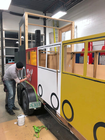 Dwelling & Design Helps with TCYP 'Toys For Tots' Parade Float