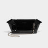 SCULPTED WING CLUTCH WITH CHAIN BLACK PATENT