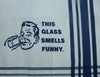 "Cream and Navy Organic Cotton Tea Towel with ""This glass smells funny."" text."
