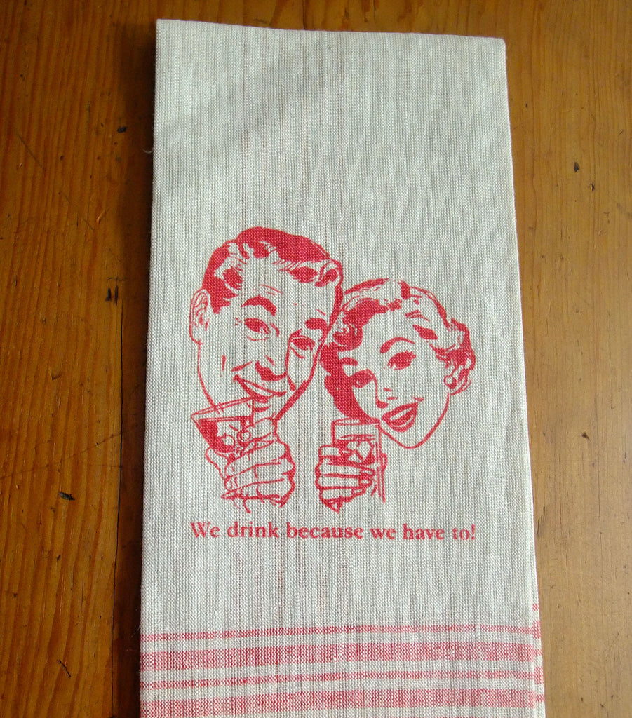 Retro couple drinking on linen cream and red linen tea towel.