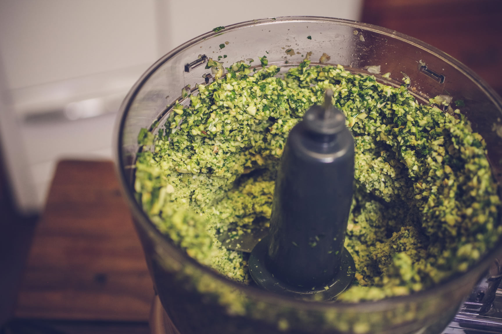 pulse herbs in food processor