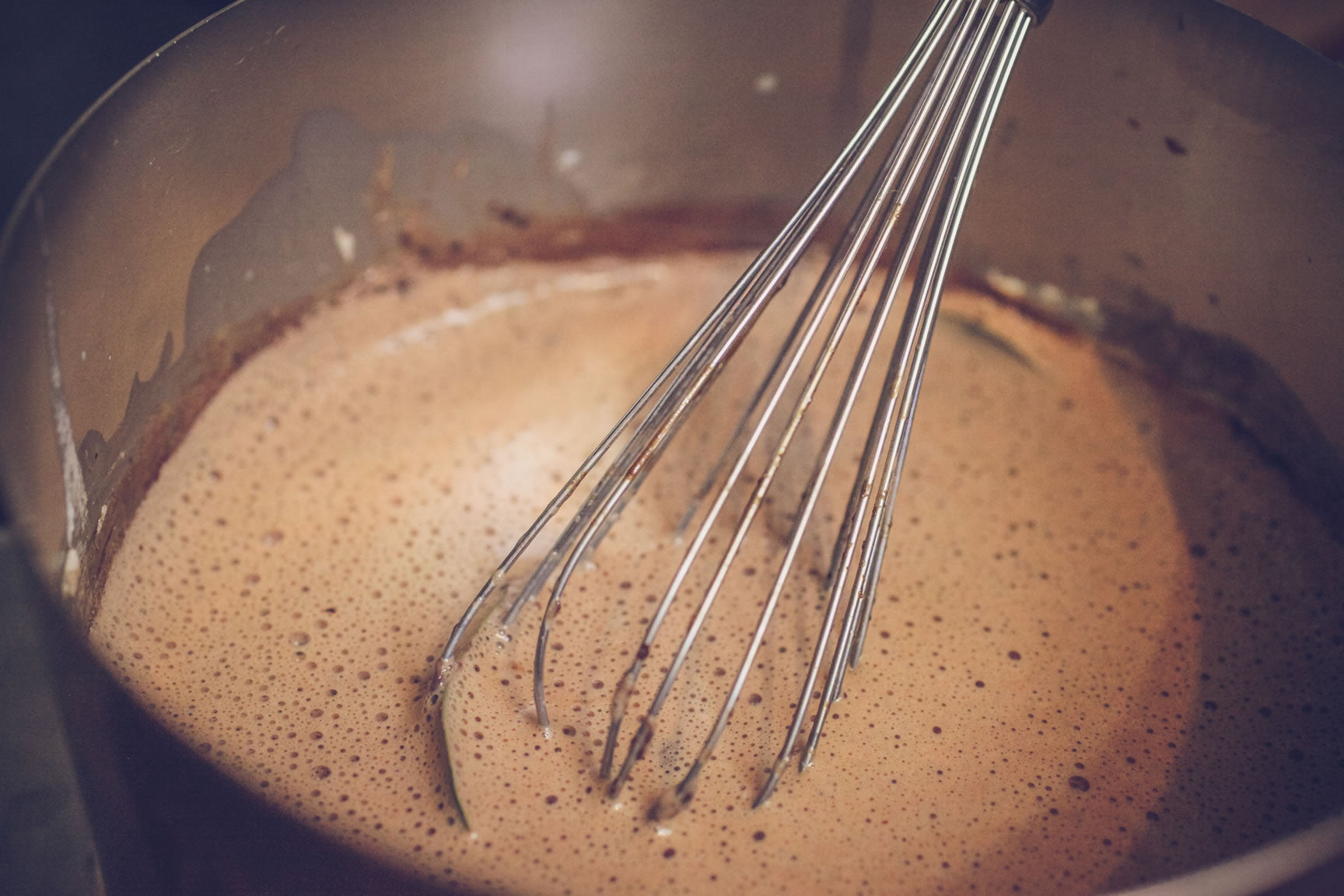 whisk over heat