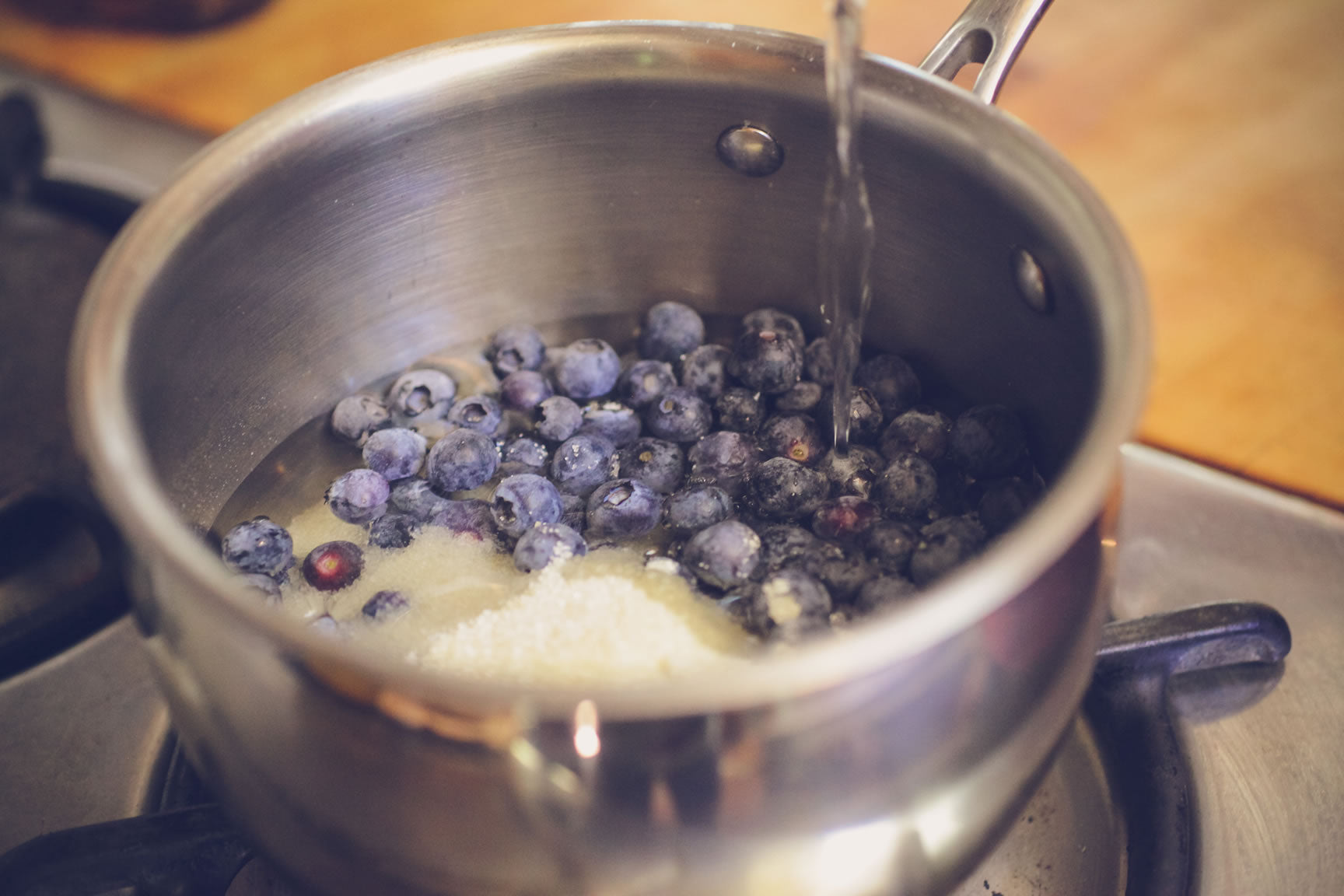 put blueberries in saucepan