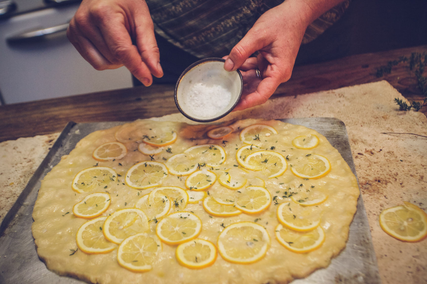 scatter salt and lemon slices