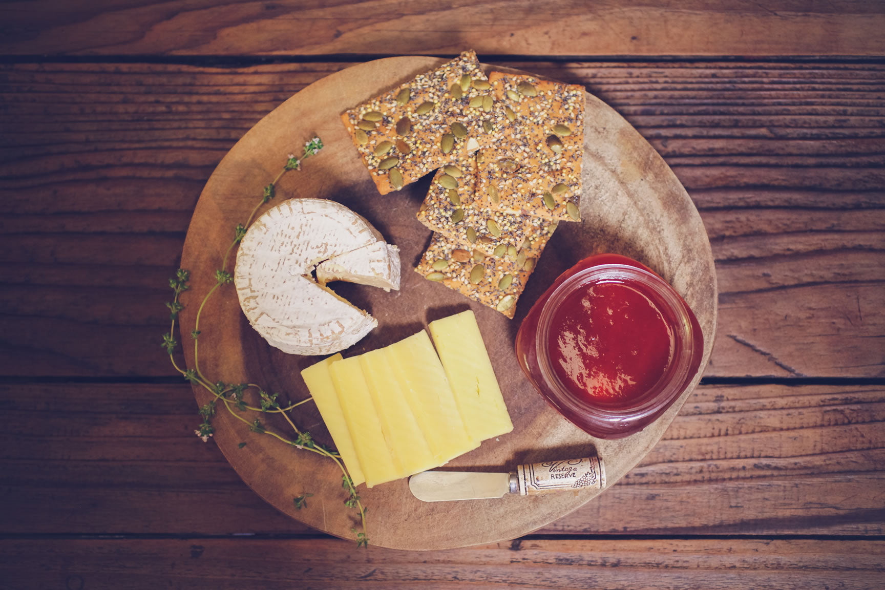 herb jelly on cheese platter