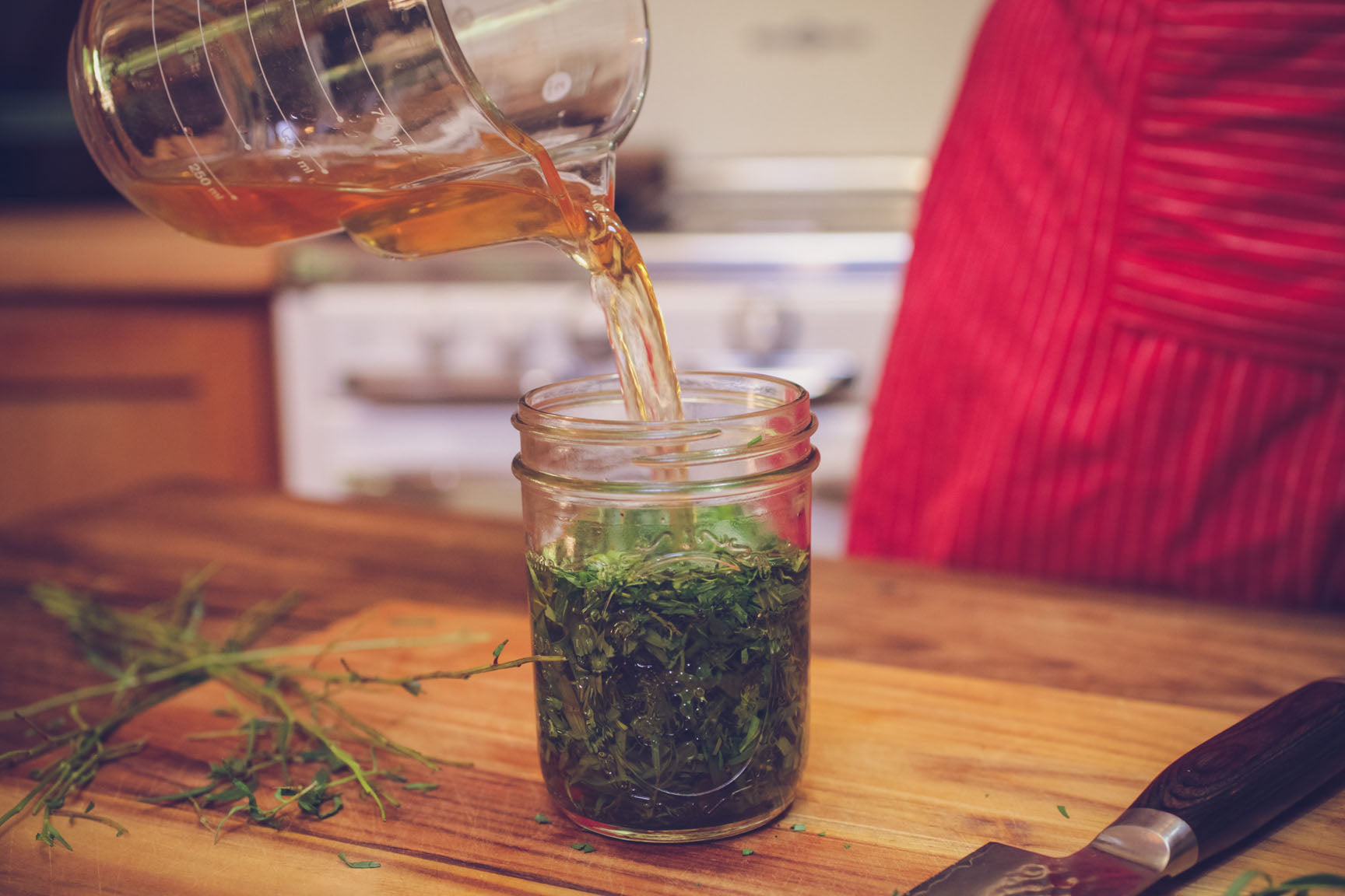 pour vinegar over herbs