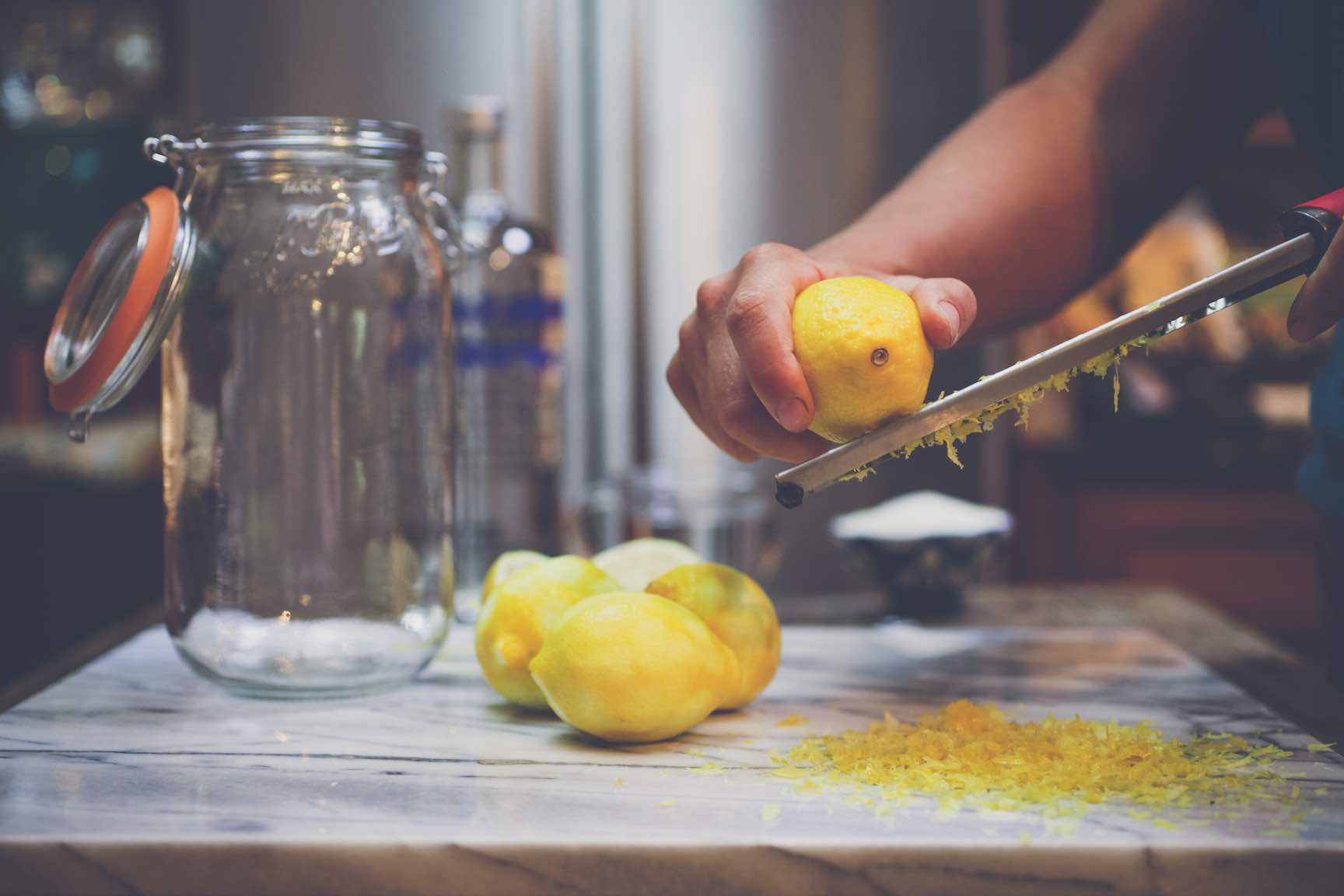 zesting lemons for homemade limoncello