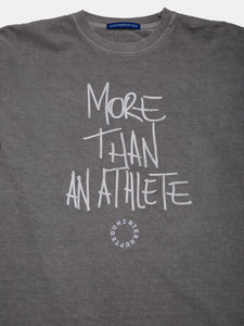 MORE THAN AN ATHLETE MULHOLLAND LS TEE CEMENT