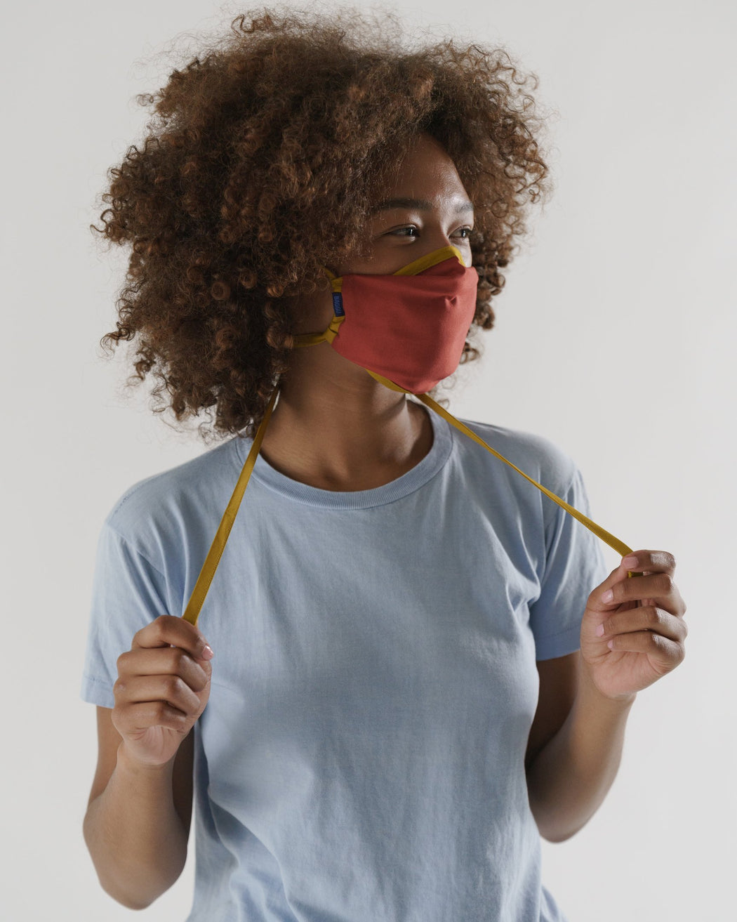 Baggu Fabric Tie Mask on model. Available at Easy Tiger Toronto.