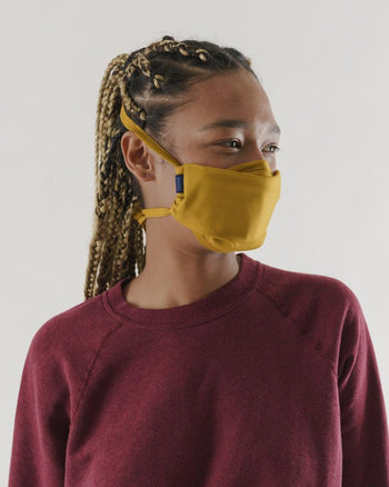 Baggu Fabric Tie Mask in MESA Golden. Available at Easy Tiger Toronto.